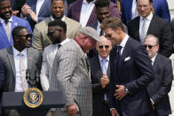 Tampa Bay Buccaneers quarterback Tom Brad moves past Tampa Bay Buccaneers head coach Bruce Arians to speak at a ceremony on the South Lawn of the White House, in Washington, Tuesday, July 20, 2021, where President Joe Biden honored the Super Bowl Champion Tampa Bay Buccaneers for their Super Bowl LV victory. Tampa Bay Buccaneers co-owner Joel Glazer is at center between Brady and Arians. (AP Photo/Andrew Harnik)