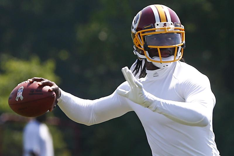 Washington Redskins quarterback Robert Griffin III (10) practices during a NFL football organized team activity at Redskins Park in Ashburn, Va., Thursday, May 30, 2013. (AP Photo/Charles Dharapak)