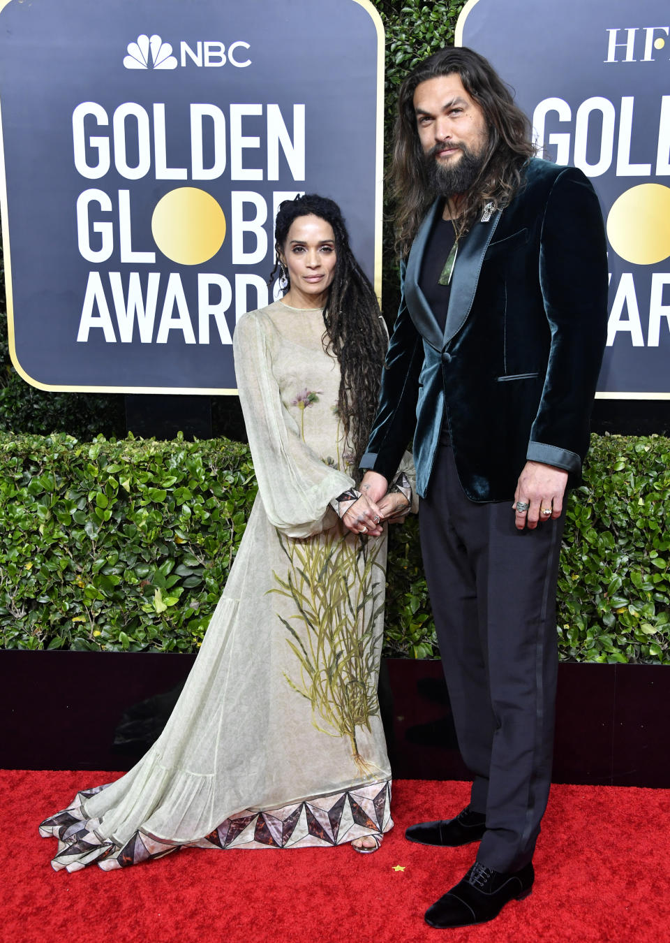 """The star of the Apple TV series """"See"""" wore a dark turquoise velvet blazer and signature flowing locks to serve as a Golden Globes presenter. (Photo by Frazer Harrison/Getty Images)"""