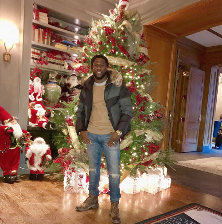 """<p>How many Santas can you count hanging around Kevin Hart's tree? """"Im in the Christmas spirit people,"""" the comedian captioned this shot. We can tell! </p>"""