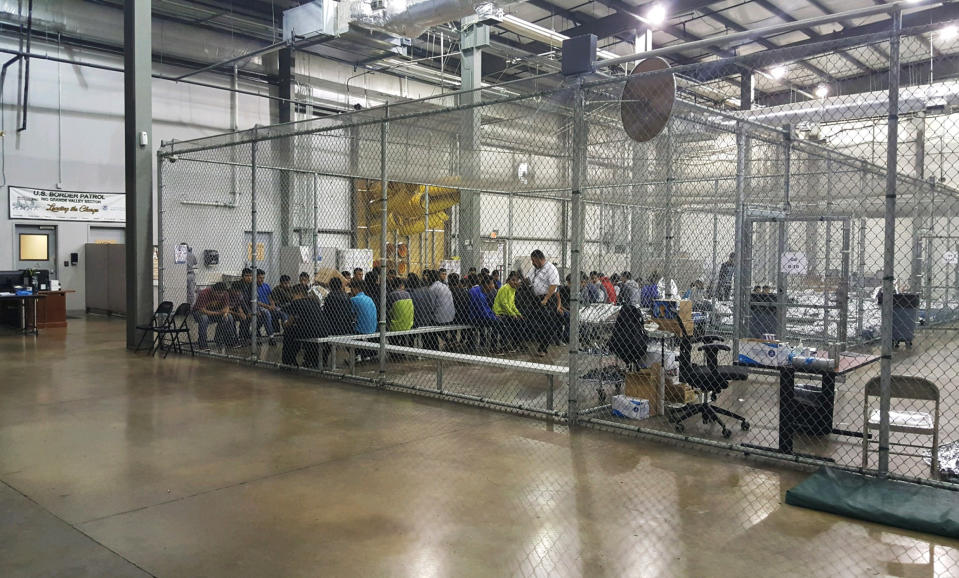 In this photo taken on Sunday, June 17, 2018 provided by U.S. Customs and Border Protection, people who've been taken into custody related to cases of illegal entry into the United States, sit in one of the cages at a facility in McAllen, Texas. As NATO allies convene, one issue not on their formal agenda but never far from their thoughts is immigration, even though illegal border crossings are decreasing on both sides of the Atlantic. The separation of families at the U.S.-Mexico border and Italy's refusal to let shipwrecked migrants disembark in its ports illustrate the hardening positions on border control in Washington and European capitals. (U.S. Customs and Border Protection's Rio Grande Valley Sector via AP)