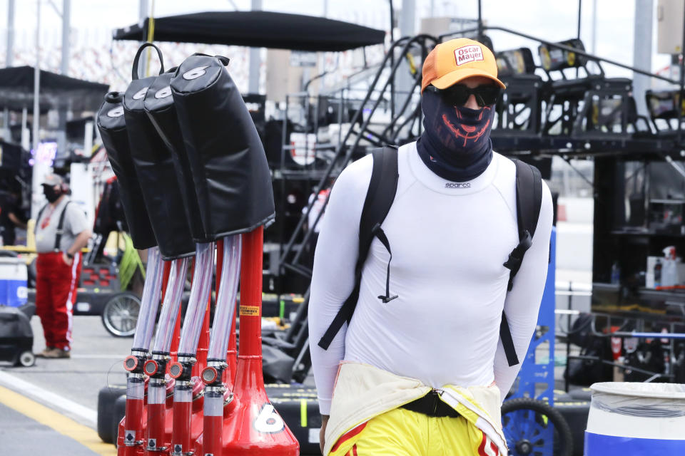 Gas cans for driver Ryan Newman are pulled through the pit area before the NASCAR Cup Series auto race Sunday, May 17, 2020, in Darlington, S.C. (AP Photo/Brynn Anderson)