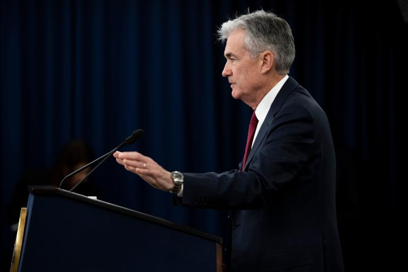 """US Federal Reserve Board Chairman Jerome Powell holds a news conference after a Federal Open Market Committee meeting in Washington, DC, December 19, 2018. - The US central bank raised the benchmark borrowing rate on Wednesday, December 19, 2018 but gave the clearest sign to date that it will go slow on additional increases as it watches the economy. Powell said that politics """"play no role whatsoever"""" in the central bank's decision making. President Donald Trump has repeatedly attacked the Fed on Twitter, calling it """"foolish"""" for considering the fourth interest rate increase of the year. In addition, Powell told reporters that the more moderate outlook for US inflation allows the Fed """"to be patient"""" with further interest rate increases. (Photo by Jim WATSON / AFP) (Photo credit should read JIM WATSON/AFP via Getty Images)"""