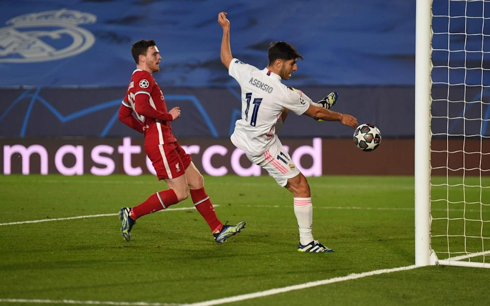 Marco Asensio of Real Madrid scores their team's second goal while pressured by Andrew Robertson of Liverpool during the UEFA Champions League Quarter Final - Denis Doyle - UEFA via Getty Images