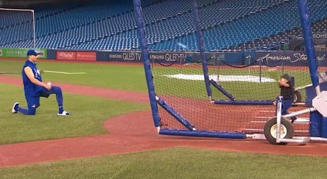 Troy Tulowitzki tests his curve ball out with son Taz.