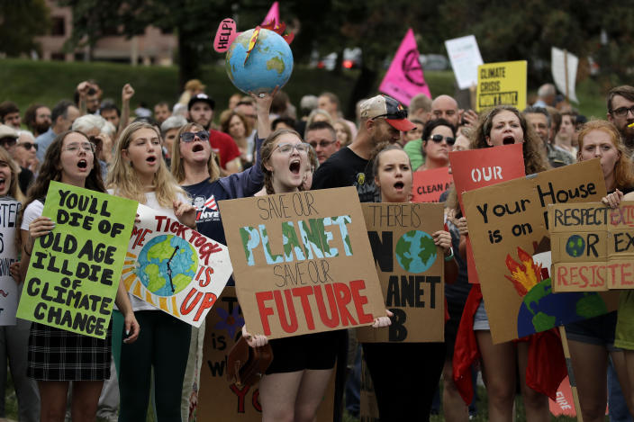 Climate protesters demonstrate on Sept. 20, 2019 in Kansas City, Mo. Across the globe, hundreds of thousands of people took the streets to demand that leaders tackle climate change in the run-up to a U.N. summit. (Charlie Riedel/AP)