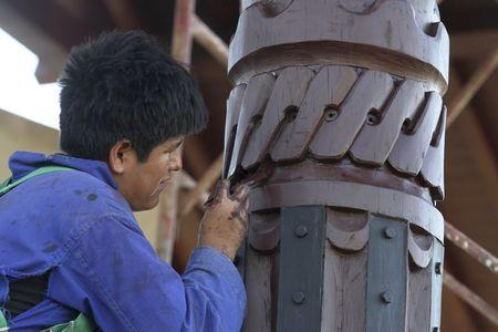 A worker crafts a structure for Pope Francis' upcoming visit to Santa Cruz