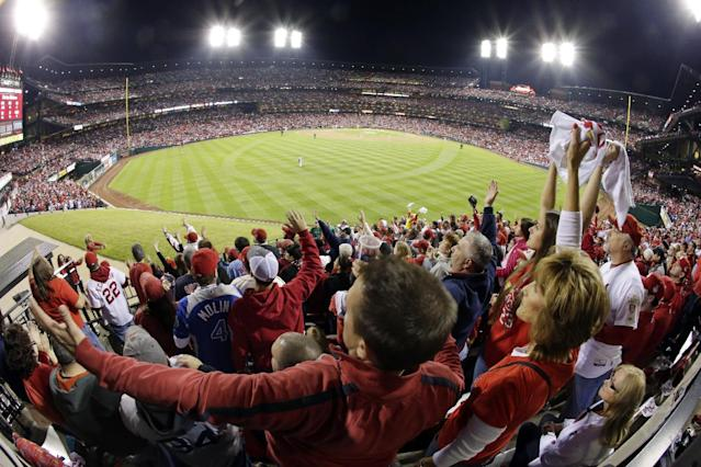 Fans cheer during the second inning of Game 5 of baseball's World Series between the Boston Red Sox and the St. Louis Cardinals Monday, Oct. 28, 2013, in St. Louis. (AP Photo/Charlie Riedel)