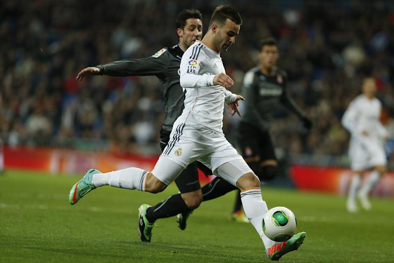 Real Madrid's Jese Rodriguez, front, scores a goal during a Copa del Rey soccer match between Real Madrid and Espanyol at the Santiago Bernabeu stadium in Madrid, Spain, Tuesday, Jan. 28, 2014. (AP Photo/Andres Kudacki)