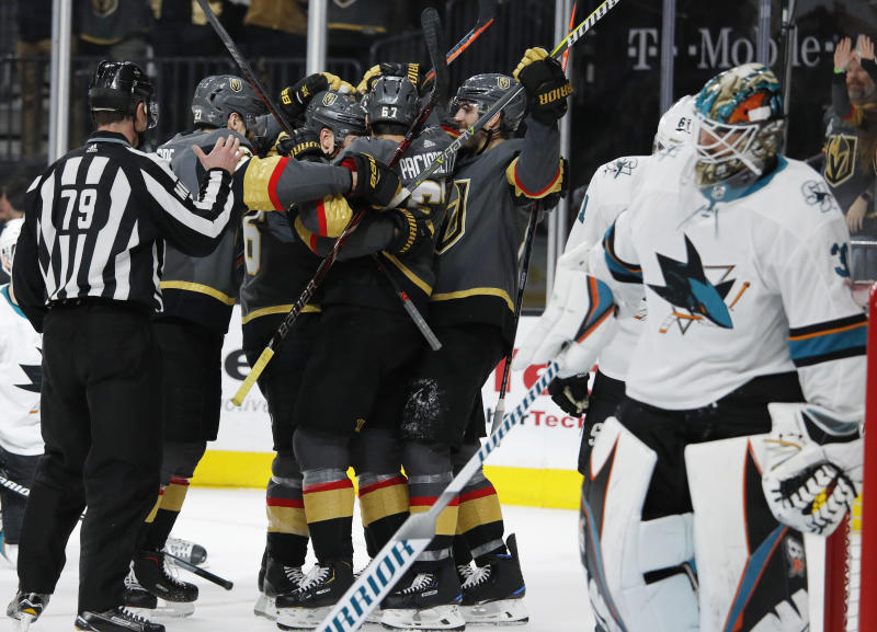 Vegas Golden Knights players celebrate after left wing Max Pacioretty scored against the San Jose Sharks during the second period of Game 4 of a first-round NHL hockey playoff series Tuesday, April 16, 2019, in Las Vegas. (AP Photo/John Locher)