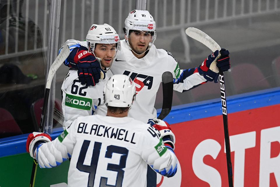 Matthew Beniers, right, congratulates Kevin Labanc, left, during the world championships. Beniers is expected to be selected No. 2 overall in the 2021 NHL draft.