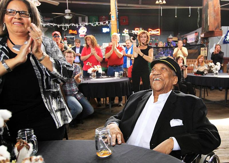 "FILE - In this Oct. 16, 2012, file photo, Bobby ""Blue"" Bland, center, is honored with a standing ovation as he is named as an inductee to the Memphis Music Hall of Fame during a ceremony at The Warehouse in Memphis, Tenn. Bland's son Rodd said his father died Sunday, June 23, 2013, at his Memphis home surrounded by relatives. He was 83. (AP Photo/The Commercial Appeal, Nikki Boertman)"