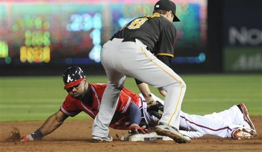 Atlanta Braves' Jason Heyward, bottom, steals second base as Pittsburgh Pirates second baseman Neil Walker (18) works during the fourth inning of a baseball game on Friday, April 27, 2012, in Atlanta. (AP Photo/Mike Stewart)