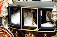 <p>There are few moments more anticipated by the public than this one. Princess Diana arrived at St. Paul's Cathedral and everyone finally got to see her dress. How Diana managed to fit all that taffeta into one carriage? The world will never know. </p>