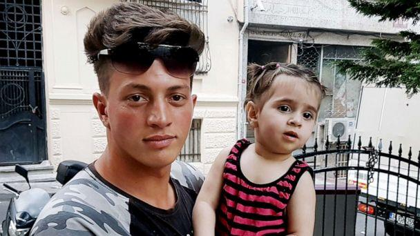 PHOTO: Algerian citizen Feuzi Zabaat poses with Syrian toddler Doha Muhammed he caught as she was falling from the second floor at Fatih district in Istanbul on June 27, 2019. (Str/AFP/Getty Images)