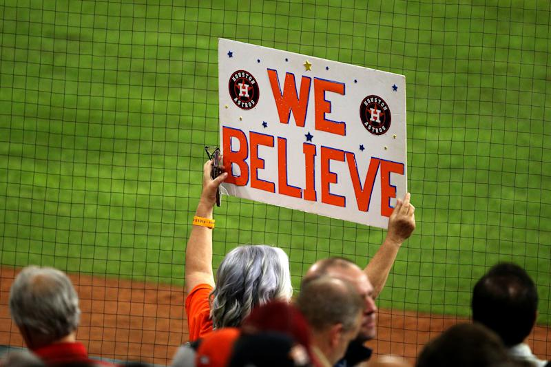 HOUSTON, TEXAS - OCTOBER 22: A fan holds a sign during the seventh inning in Game One of the 2019 World Series between the Houston Astros and the Washington Nationals at Minute Maid Park on October 22, 2019 in Houston, Texas. (Photo by Bob Levey/Getty Images)
