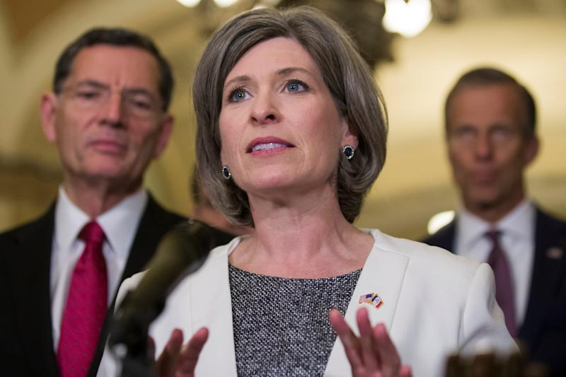 Sen. Joni Ernst, R-Iowa, speaks during a media availability after their policy luncheon on Capitol Hill, Tuesday, May 7, 2019 in Washington. Ernst is accompanied by Sen. John Barrasso, R-Wyo., left, and Sen. John Thune, R-S.D. (AP Photo/Alex Brandon)