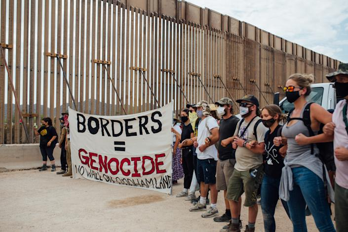 Protesters make a line taking over the construction site of the border wall along the reservation near Quitobaquito on Sept. 21, 2020, in Organ Pipe Cactus National Park.