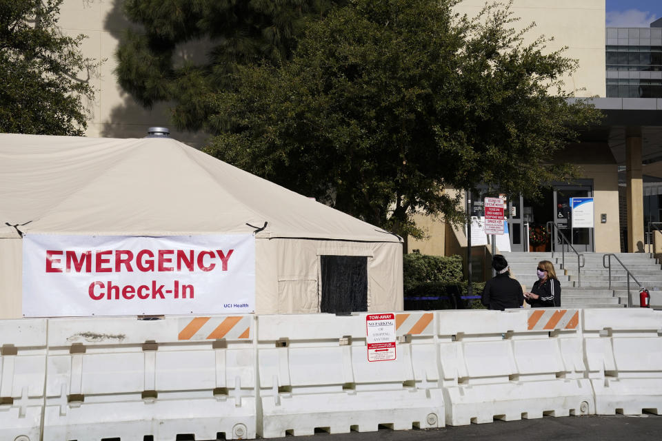 "FILE - In this Dec. 17, 2020, file photo, medical tents are set up outside the emergency room at UCI Medical Center in Irvine, Calif. Doctors said on Friday, Dec. 18, increasingly desperate California hospitals are being ""crushed"" by soaring coronavirus infections. (AP Photo/Ashley Landis, File)"