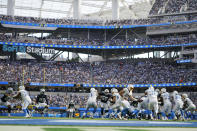 Los Angeles Chargers quarterback Justin Herbert hands off to running back Austin Ekeler (30) during the second half of an NFL football game Sunday, Sept. 19, 2021, in Inglewood, Calif. (AP Photo/Ashley Landis)