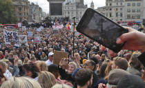 People take part in a 'We Do Not Consent' rally at Trafalgar Square, organised by Stop New Normal, to protest against coronavirus restrictions, in London, Saturday, Sept. 26, 2020. (AP Photo/Frank Augstein)