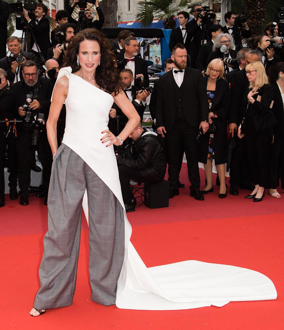 Wearing white one-shouldered top with train and grey wide-leg trousers. <em>[Photo: Getty]</em>