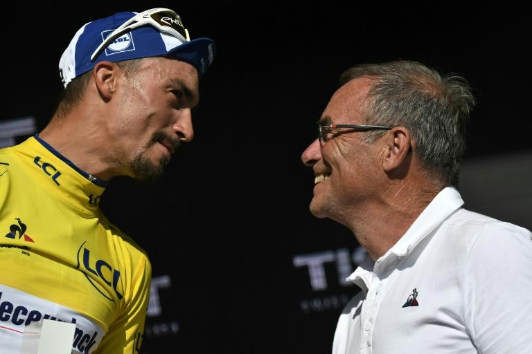 Alaphilippe being congratulated by Bernard Hinault