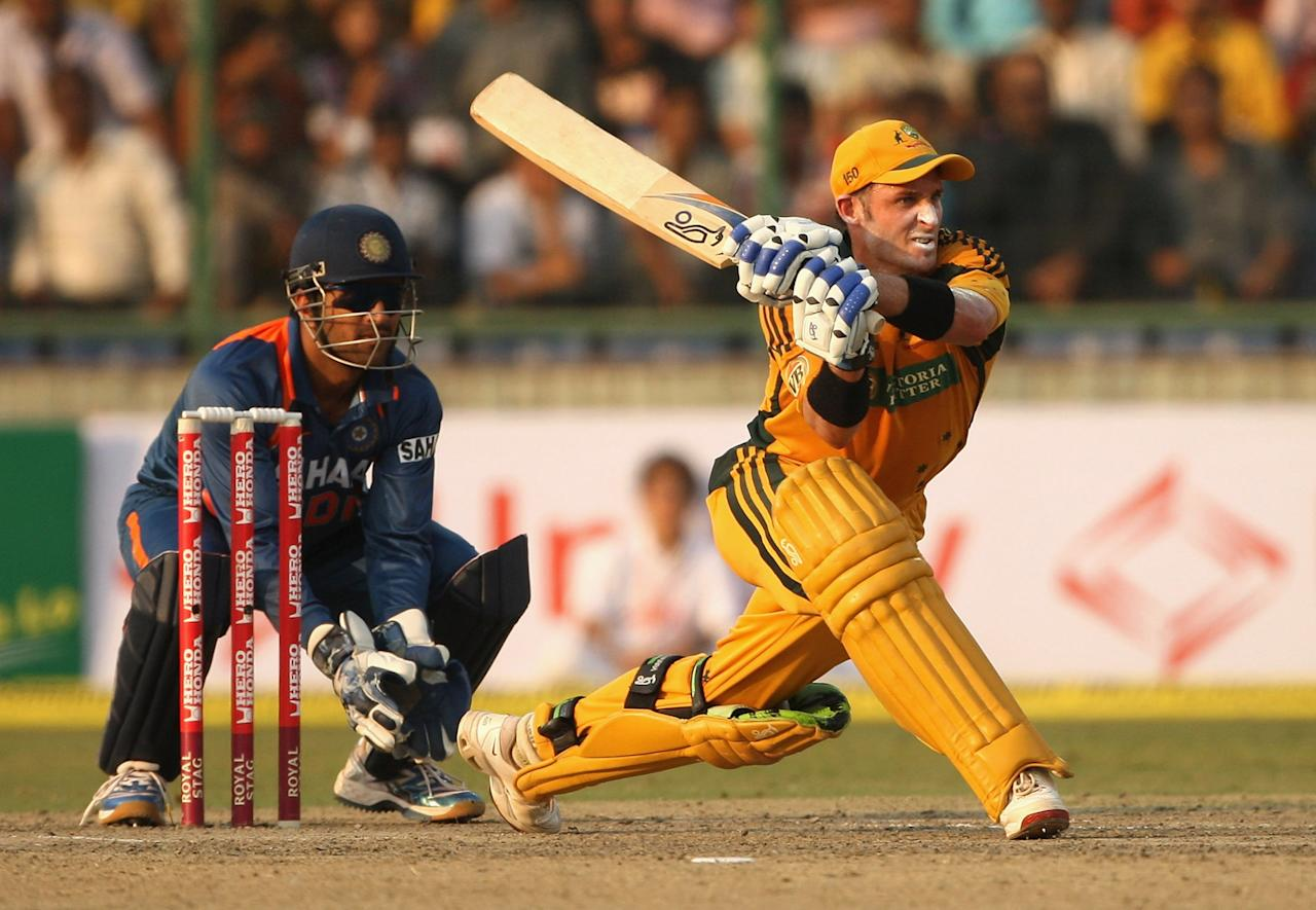 Mike Hussey of Australia plays a reverse sweep during the third One Day International match between India and Australia at Feroz Shah Kotla on October 31, 2009 in Delhi, India. (Photo by Mark Kolbe/Getty Images)