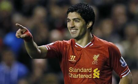 Liverpool's Luis Suarez celebrates after scoring during their English Premier League soccer match against West Ham United at Anfield in Liverpool, northern England December 7, 2013. REUTERS/Phil Noble
