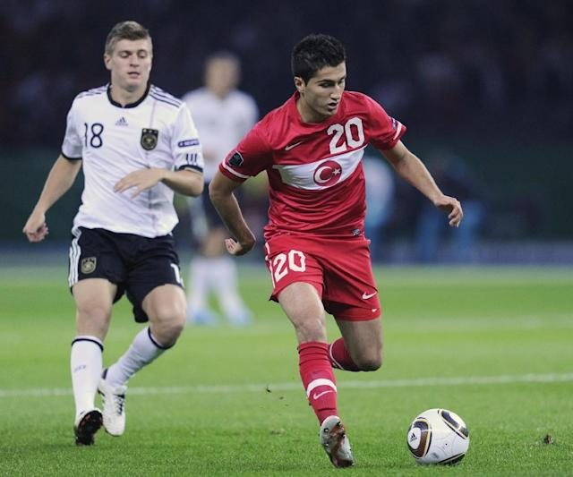 "29-year-old Nuri Sahin, pictured during a Euro 2012 match against Germany, announced he was leaving the Turkish squad ""to give way to a newer generation"" (AFP Photo/ODD ANDERSEN)"
