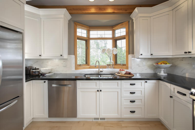 White home showcase interior kitchen with bay window over sink