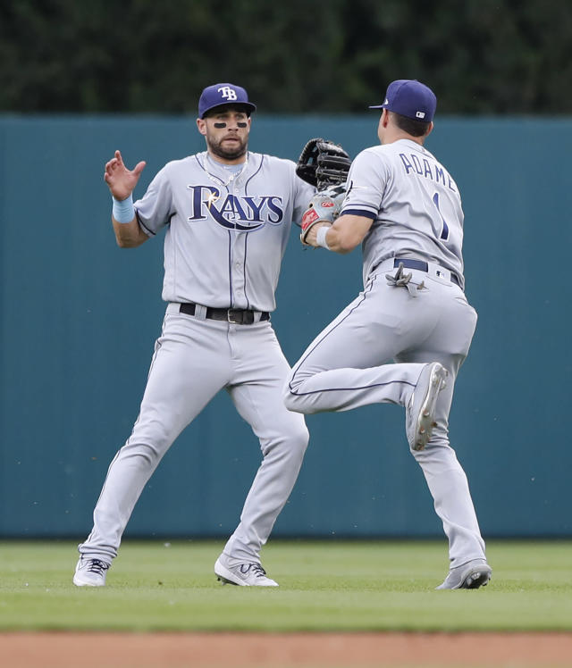 Tampa Bay Rays shortstop Willy Adames (1) catches the ball for the out on a ball hit by Detroit Tigers' Christin Stewart, and avoids Kevin Kiermaier during the first inning of a baseball game Wednesday, June 5, 2019, in Detroit. (AP Photo/Carlos Osorio)