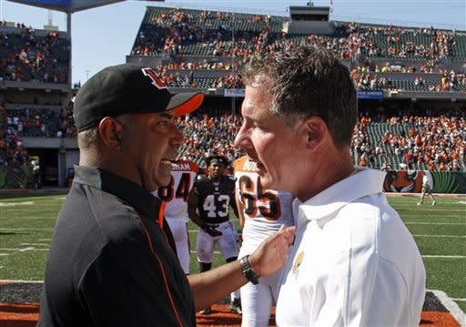 Cincinnati Bengals head coach Marvin Lewis, left, meets with Cleveland Browns head coach Pat Shurmur after the Bengals defeated the Browns 34-27 in an NFL football game on Sunday, Sept. 16, 2012, in Cincinnati. (AP Photo/Tom Uhlman)