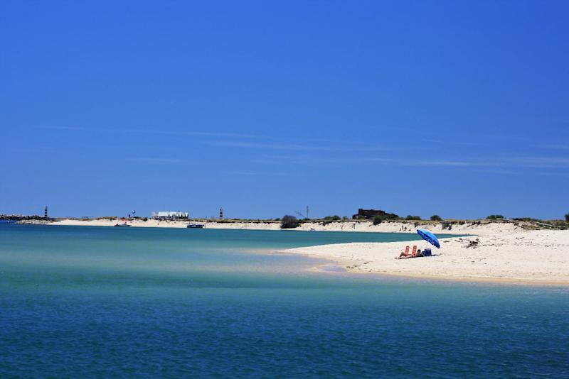 This photo provided by the Portuguese National Tourist Office shows Ilha Deserta, an island in Faro, off Portugal's southern coast. The scenic island, which is reachable by ferry, has a white sand beach, nature trail and lighthouses. (AP Photo/Portuguese National Tourist Office, Animaris)
