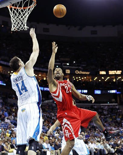 Houston Rockets center Marcus Camby (29) shoots over New Orleans Hornets power forward Jason Smith (14) in the first half of an NBA basketball game in New Orleans, Thursday, April 19, 2012. (AP Photo/Gerald Herbert)