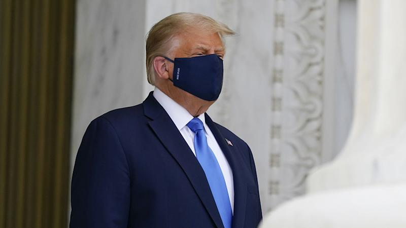 President Trump wears a mask while paying respects to the late Ruth Bader Ginsburg