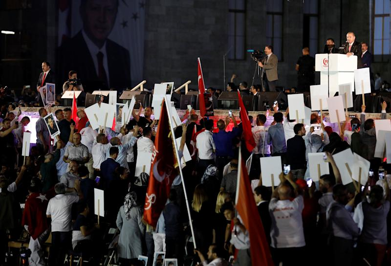 Turkey's President Tayyip Erdogan addresses his supporters during a ceremony marking the first anniversary of the attempted coup in front of the Turkish Parliament in Ankara