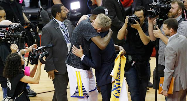 Kevin Durant and Steve Kerr share a moment after winning Game 7 of the 2018 Western Conference finals. (Getty Images)