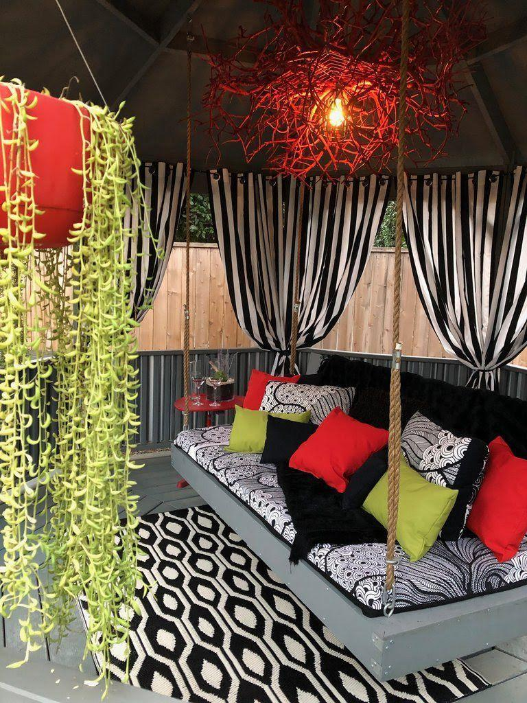 """<p>Black and white striped curtains and a few patterned pillows are all you need to create a cabana-style getaway in your own backyard. This tutorial offers an excellent way to bring modern flare to a traditional wood gazebo. </p><p><strong>Get the look at <a href=""""https://www.pattiewack.com/blogs/news/diy-cabana-style-gazebo-makeover"""" rel=""""nofollow noopener"""" target=""""_blank"""" data-ylk=""""slk:Pattie Wack"""" class=""""link rapid-noclick-resp"""">Pattie Wack</a>. </strong></p><p><a class=""""link rapid-noclick-resp"""" href=""""https://www.amazon.com/Outdoor-Decor-Coastal-Stripe-Cabana/dp/B079YZHZ8J/?tag=syn-yahoo-20&ascsubtag=%5Bartid%7C10050.g.30932979%5Bsrc%7Cyahoo-us"""" rel=""""nofollow noopener"""" target=""""_blank"""" data-ylk=""""slk:SHOP CABANA CURTAINS"""">SHOP CABANA CURTAINS</a></p>"""