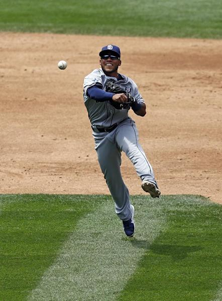 San Diego Padres third baseman Alexi Amarista throws out Colorado Rockies' Charlie Blackmon at first during the third inning of a baseball game on Wednesday, July 9, 2014, in Denver. (AP Photo/Jack Dempsey)