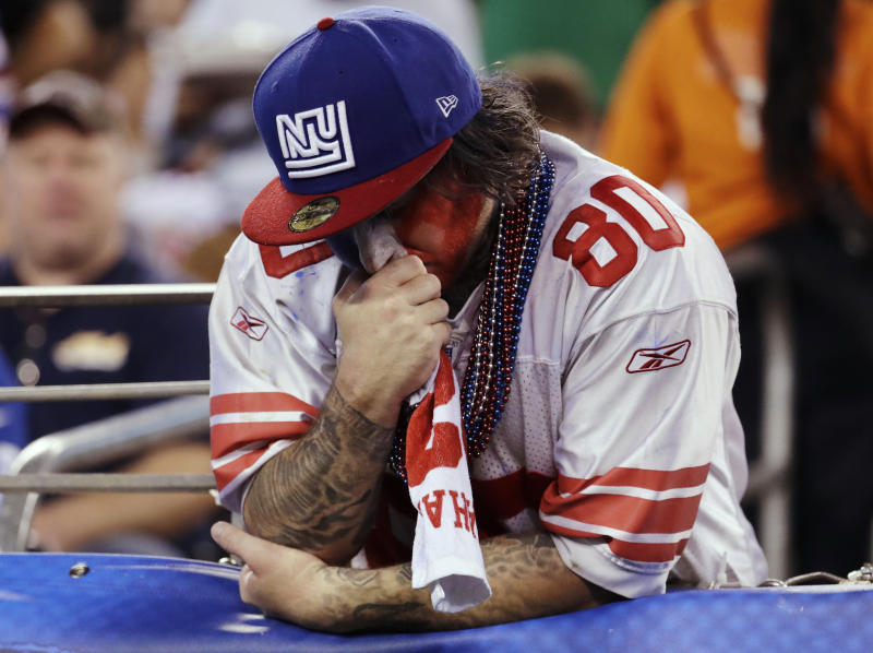 A New York Giants fan reacts during the first half of the team's NFL football game against the Philadelphia Eagles on Thursday, Oct. 11, 2018, in East Rutherford, N.J. (AP Photo/Julio Cortez)