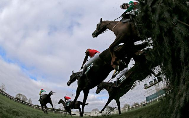 <span>Horses negotiate the Canal Turn at Aintree in the 2017 Grand National</span> <span>Credit: Jason Cairnduff/REUTERS </span>