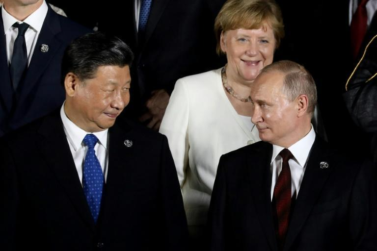 Many hail Merkel as a welcome counter-balance to the big, brash men of global politics (AFP/Dominique JACOVIDES)