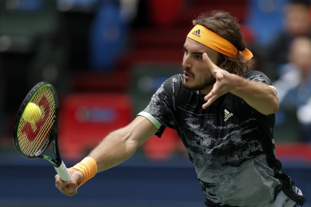 Stefanos Tsitsipas of Greec hits a return against Felix Auger-Aliassime of Canada during the men's singles match at the Shanghai Masters tennis tournament at Qizhong Forest Sports City Tennis Center in Shanghai, China, Wednesday, Oct. 9, 2019. (AP Photo/Andy Wong)