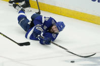 Tampa Bay Lightning right wing Nikita Kucherov (86) reaches for the loose puck during the second period in Game 2 of the NHL hockey Stanley Cup finals against the Montreal Canadiens, Wednesday, June 30, 2021, in Tampa, Fla. (AP Photo/Gerry Broome)