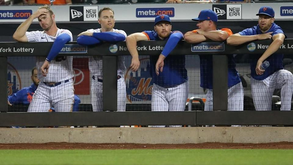 Aug 24, 2021; New York City, New York, USA; New York Mets first baseman Pete Alonso (left to right), center fielder Brandon Nimmo (9), infielder Brandon Drury (35), catcher James McCann (33) and injured starting pitcher Jacob deGrom (48) watch during the ninth inning against the San Francisco Giants at Citi Field.