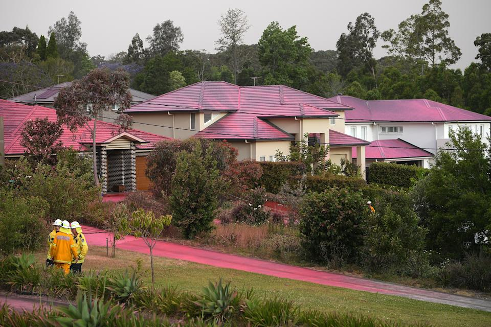 Picture of the pink long-term fire retardant on homes and driveways in the Sydney suburb of Turramurra.