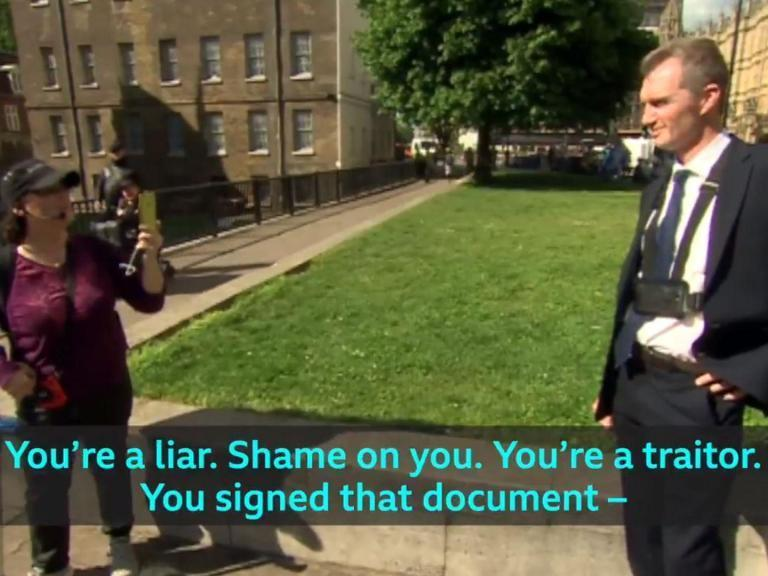 """A Conservative Brexiteer MP has been called a """"liar"""" and a """"traitor"""" during an extraordinary exchange with a Leave supporter during a television interview.David Davies was speaking to BBC Wales outside parliament about a rise in abuse towards politicians when he was confronted by a passing woman, who accused him of """"acting like a snowflake"""" and being a """"remoaner"""".""""I voted to leave, actually,"""" the Monmouth MP responded. """"I'm not a snowflake.""""He added: """"I was actually campaigning for Brexit and have been for years, so I don't need to be given lectures by people like you.""""But the woman, wearing a microphone and filming Mr Davies on her mobile phone, told the Conservative he was """"a liar"""" after he confirmed he voted for Theresa May's Brexit deal.""""Shame on you. You're a traitor,"""" she added. """"You've betrayed 17.4 million people.""""Mr Davies responded: """"I tell you what, people like you make me want to join the EU again quite honestly.""""Turning to the camera towards the end of the three-minute exchange, the Tory MP said: """"And that's what you have to put up with when you're out here all the time.""""One viewer, writing on Twitter, said the confrontation between two staunch Leave supporters """"kind of sums the whole sorry mess"""" of Brexit.""""BBC manages to find the personification of Brexit during David Davies interview,"""" added another.A third wrote: """"David Davies meets the contents of Pandora's box. Wonder if it's sunk in yet?""""Labour Welsh Assembly member Alun Davies said the spat """"showed the need for a conversation about how we can disagree with each other, have a serious debate and rebuild our politics"""".Mr Davies replied: """"I can start by agreeing with you 100% on that Alun!""""The Tory MP has taken to wearing a GoPro camera around his neck in public to document any abuse from members of the public.He told The Independent in January the footage he captured was also for his """"protection"""" against """"malicious allegations""""."""