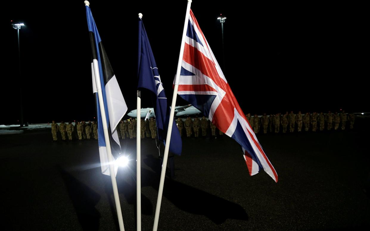 <span>The flags Estonia, NATO and Britain at the arrival ceremony </span> <span>Credit: INTS KALNINS /Reuters </span>