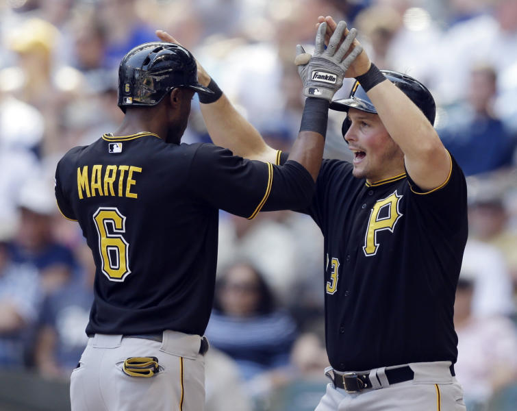 Pittsburgh Pirates' Starling Marte, left, and Travis Snider high-five after Marte's two-run home run against the Milwaukee Brewers in the eighth inning of a baseball game Wednesday, May 1, 2013, in Milwaukee. (AP Photo/Jeffrey Phelps)